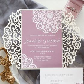 elegant ivory laser cut invitation with background in mauve colors SWWS084