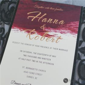 modern black laser cut invitation with burgundy watercolor inside design and gold ribbon SWWS094